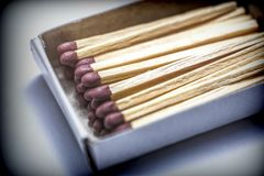 Some matches in a pasteboard box  on white fund. Conceptual image Stock Photo