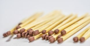 Some matches stacked  on white background. Conceptual image Stock Photography