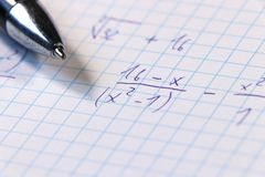 A some math example on math lesson or example for homeworks. Also we can see blue pen. Schoolwork for university students royalty free stock images