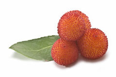 Some mature arbutus fruits. Stock Photo