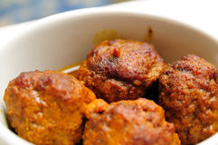 Some Meatballs. Four big beef meatballs with a light sauce stock photos