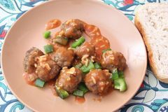 Meatballs of minced meat. Some meatballs of minced meat with a sauce of tomatoes and rice Royalty Free Stock Images