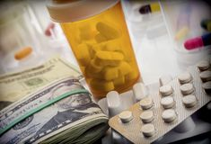 Some medications on a ticket of dollar. Conceptual image copay health royalty free stock photography