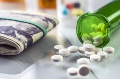 Some medications on a ticket of dollar. Conceptual image copay health stock images
