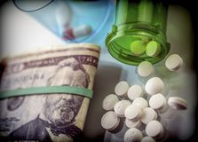 Some medications on a ticket of dollar. Conceptual image copay health Stock Photography