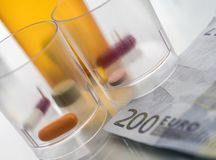 Some medicines along with a ticket of 200 euros, conceptual image. Copay health Stock Photos