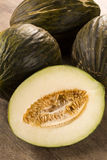 Some melons over a wooden surface Royalty Free Stock Images