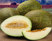 Some melons over a wooden surface Royalty Free Stock Photography