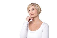 Some memories i never forgot. Pensive woman touching her face over white Stock Photo