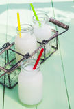 Some milky drinks. In a tray for lunch time outdoors Stock Image