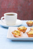 Some mini cupcake and coffee. Some cupcake and coffee isolated on blue Royalty Free Stock Images