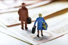 Miniature travelers on euro banknotes royalty free stock image