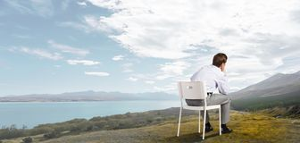 Some minutes of isolation!. Young businessman sitting in chair and relaxing royalty free stock photo