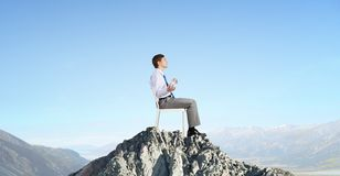 Some minutes of isolation!. Young businessman sitting in chair and relaxing royalty free stock images