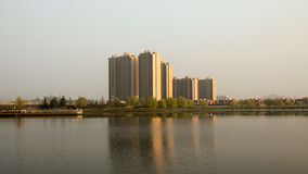 Some Modern buildings. Modern buildings in China and their felections in a lake Stock Images