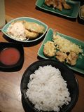 Some Modern Japanese Style Dinner. A bowl of rice, onion rings, tempura, and some chicken karaage for dinner Stock Photos