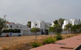 Some modern white houses near Gata Bay in Andalusia (Spain). Photo taken near Gata Bay in Andalusia (Spain). The photo, taken from an adjacent street, picks up Stock Photo