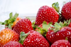 Some more super sweet strawberry;s with green tops stock images