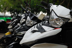 Some motorcycles parked at a roadside. Royalty Free Stock Photos