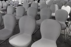 Rows of white chairs for audience royalty free stock photos