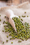 Some Mung Beans. On an old wooden table (close-up shot Stock Photography