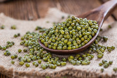 Some Mung Beans. On an old wooden table (close-up shot Stock Images