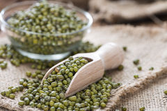 Some Mung Beans. On an old wooden table (close-up shot Royalty Free Stock Photos