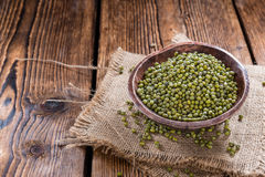 Some Mung Beans. On an old wooden table (close-up shot Stock Photo