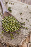 Some Mung Beans. On an old wooden table (close-up shot Royalty Free Stock Image