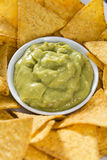 Some Nachos (with Guacamole) on wood. En background (close-up shot Royalty Free Stock Images