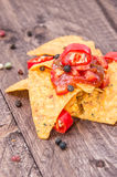 Some Nachos with Salsa Sauce. On wooden background Stock Photo