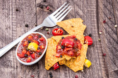 Some Nachos with Salsa Sauce. On wooden background Royalty Free Stock Image