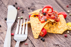 Some Nachos with Salsa Sauce. On wooden background stock photography