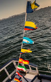 Some national flags fluttering on the rope. On deck stock image