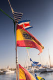 Some national flags fluttering on the rope. On deck royalty free stock image