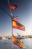 Some national flags fluttering on the rope. On deck royalty free stock photos