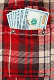 New dollar notes in checkered shirt pocket Stock Photography