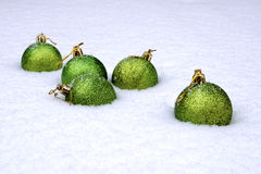 Some New Year's balls. In a snowdrift stock photography