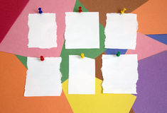 Some notepad on colored background. Push-pins and white notepad on colored background Stock Photos