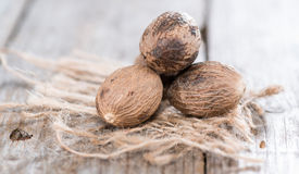 Some Nutmegs (close-up shot) Stock Images