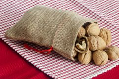 A some nuts. Inside a jute bag Stock Photos