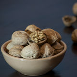 Some nuts on the table. Some nuts in a container on the table stock image