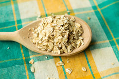 Some oatmeal in the wooden spoon. The most useful food for breakfast Royalty Free Stock Photography