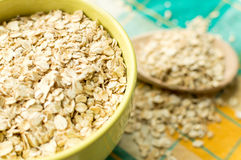 Some oatmeal in the wooden spoon. The most useful food for breakfast Royalty Free Stock Photos