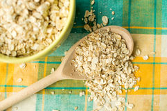 Some oatmeal in the wooden spoon. The most useful food for breakfast Stock Photography