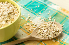 Some oatmeal in the wooden spoon. The most useful food for breakfast Stock Image