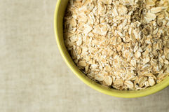 Some oatmeal in the wooden spoon Royalty Free Stock Images