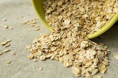 Some oatmeal in the wooden spoon. The most useful food for breakfast Stock Photo