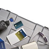 Some Objects for tour abroad. Top view of travel accessories lying on gray suitcase royalty free stock photos