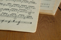 Some old music books on a wooden surface. Close up stock photos